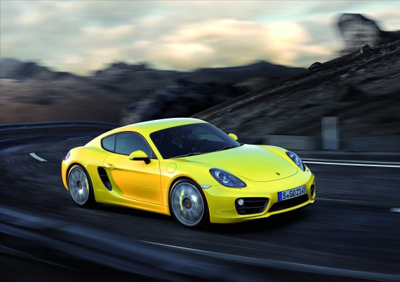 EMBARGO_28.11.12_2030hrs_The_New_Porsche_Cayman_Racing_Yellow_Action_Front__3-4.jpg